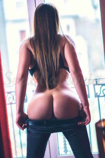 ass of escort on the window